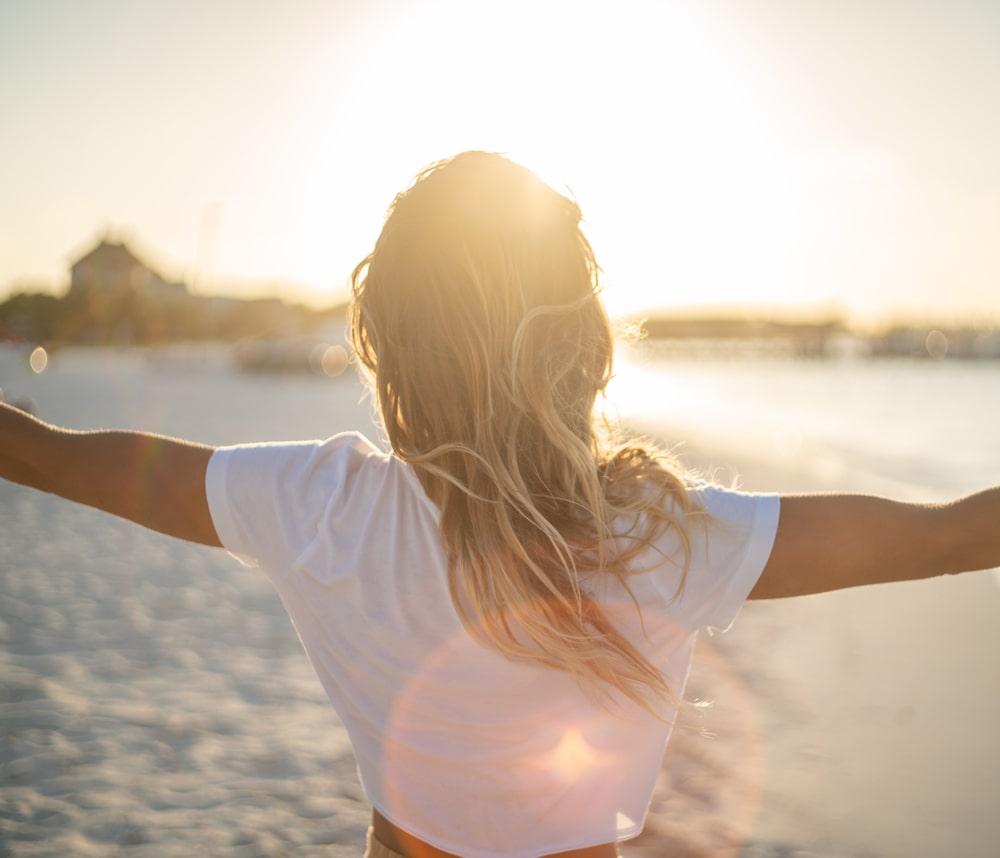 Healed woman enjoying beach